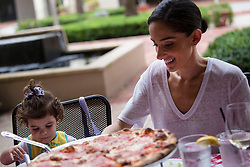 October 7, 2016 - Florida, U.S. - Seta Goldstein dines out with her daughter Olivia, 2, at Grimaldi's Pizzeria in Downtown at the Gardens, Friday  afternoon after the passing of Hurricane Matthew, October 7, 2016 in Palm Beach Gardens. (Credit Image: © Yuting Jiang/The Palm Beach Post via ZUMA Wire)