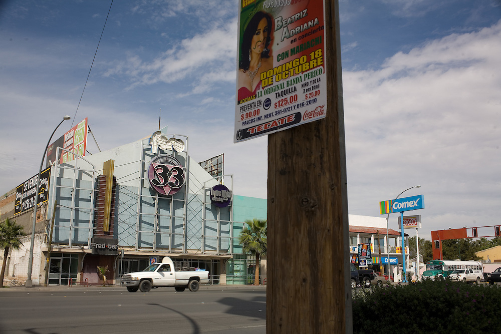 """.A truck passes the old """"Live 33"""" in Juarez Mexico on Saturday, Oct. 10, 2009.."""