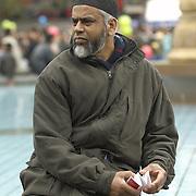 Muslim man in the crowd atEid in the Square, Trafalgar Square, London<br />