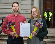 Campaigners from climate change charity 10:10 then took bouquets of pinwheels to the Treasury along with a petition signed by just under 18,000 wind power supporters. As scientists declare 2016 the hottest year on record, campaigners are calling for government funds to be urgently redirected away from fossil fuels and to the development of clean energy. Parliament square, Westminster London. 17th November 2016. <br /> (photo by Andrew Aitchison )