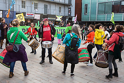 London, UK. 9th February, 2019. Drummers entertain activists from Extinction Rebellion in Gillett Square in Dalston as part of a 'Saturday street party' intended as a means of engagement around climate change and environmental issues with the local community.