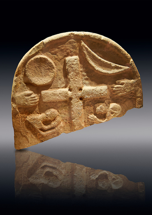 The Viking Raiders Stone with a central cross, a sun and a moon, two hands and two figures praying. Anglo Saxon probably carved as a memorial of the first Viking Raind on Lindisfarne Island in 793. Lindisfarne Abbey Museum, Northumbria, England