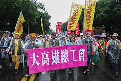 May 1, 2019 - Taipei, Taiwan - Protesters marching with banners and flags calling for more holidays, paid leave, more labour rights protections. During 2019 Labor Day March 6,000 workers took the streets of Taipei City, Taiwan, on 1st May 2019,  calling for more holidays, paid leave, more labour rights protections. (Credit Image: © Jose Lopes Amaral/NurPhoto via ZUMA Press)