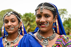 © Licensed to London News Pictures. 18/08/2018. LONDON, UK. Dancers in traditional costumes prepare to perform at the ZEE London Mela, in Southall Park near to Europe's oldest Asian community in Southall, west London. Now in its 16th year, the weekend festival includes music, dance and cultural activities, inspired by South Asia and the diaspora.  Photo credit: Stephen Chung/LNP
