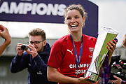 Arsenal midfielder Dominique Bloodworth (20) celebrating  with the WSL trophy after  the FA Women's Super League match between Arsenal Women FC and Manchester City Women at Meadow Park, Borehamwood, United Kingdom on 12 May 2019.