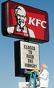"""This handout photo from KFC shows Colonel Sanders look-alike Bob Thompson changing the reader board Tuesday, Sept. 29, 2009 in Louisville, Ky., to show that a KFC restaurant has been converted into a """"World Hunger Relief Kitchen"""" during the lunch rush to feed residents of the local Wayside Christian Mission. KFCs across the country will be collecting donations for World Hunger Relief now through the end of October. (Photo by Brian Bohannon)."""
