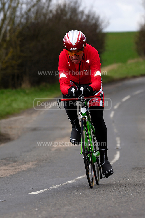United Kingdom, Finchingfield, Mar 27, 2010:  Alan Harvey, Shorter Rochford RT, approaches the 4 miles to go marker during the 'Jim Perrin' Memorial Hardriders 25.5 mile Sporting TT promoted by Chelmer Cycling Club. Copyright 2010 Peter Horrell.