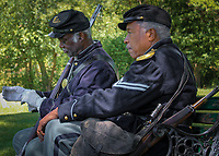 A moment captured while honoring our Serviceman and Servicewomen at Midland Cemetery in Steelton Pennsylvania 2015 Memorial Day Remembrance. Two of the members from the 3rd Regiment U.S. Colored Troops based out of Philadelphia Pennsylvania (Founded August 1863) – Color Sgt. Larry Harris (left) and Cpl. Robert Fuller Houston (right). The 3rd USCT faithfully attends not only Midlands event but many others thru out the years. Living history at its best!