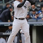 Brian McCann, New York Yankees, batting during the New York Yankees V Baltimore Orioles home opening day at Yankee Stadium, The Bronx, New York. 7th April 2014. Photo Tim Clayton