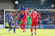 AFC Wimbledon defender Deji Oshilaja (4) winning header during the EFL Sky Bet League 1 match between AFC Wimbledon and Scunthorpe United at the Cherry Red Records Stadium, Kingston, England on 15 September 2018.