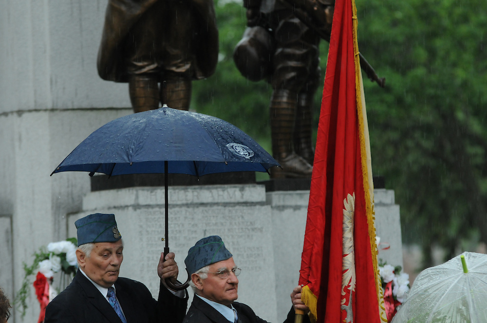 Jerzy Darski and Zigmund Golinski of the Polish Army Veterans Association of America commemorate Memorial Day with fellow members near a veteran's monument at St. Adalbert Cemetery in Niles.