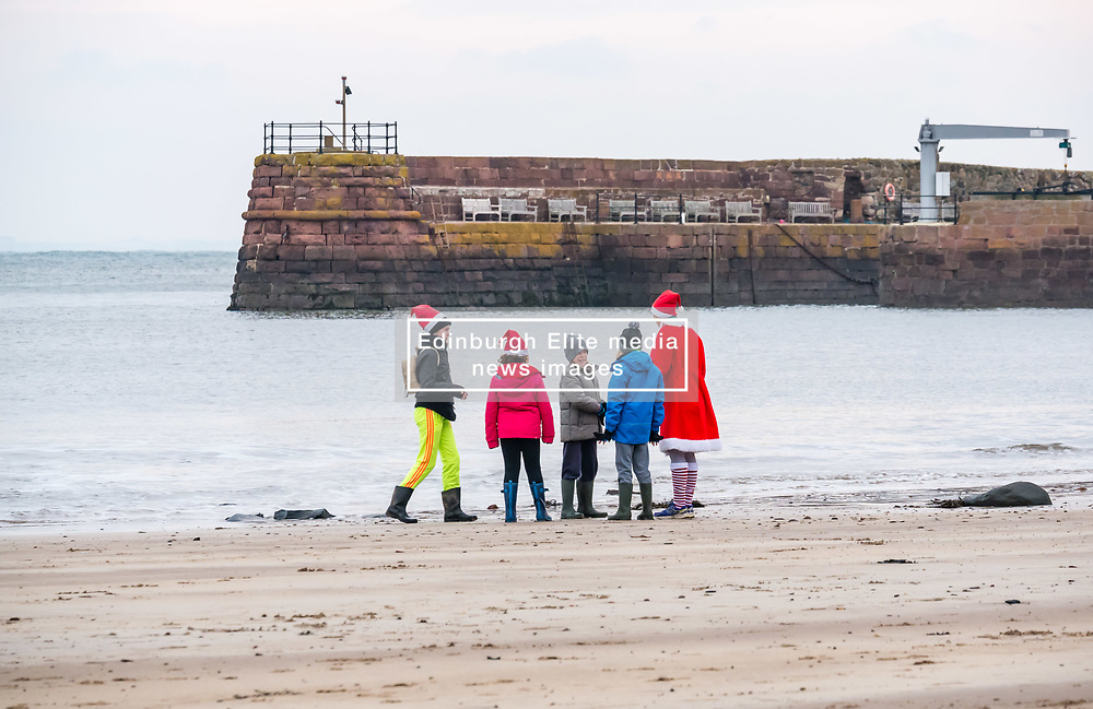 Pictured: Santa Beach Run on the scenic East Lothian coast. This new event is aimed at athletes, casual runners and families. It is hosted by Project Trust with proceeds enabling local school leavers to spend a year volunteering in India/Honduras to teach at a school with few teaching materials. 15 December 2018  <br /> <br /> Sally Anderson | EdinburghElitemedia.co.uk