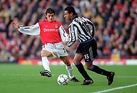 Nelson Vivas (Arsenal) Nol Solano (Newcastle United). Arsenal 5:0 Newcastle United, F.A.Carling Premiership, 9/12/2000. Credit Colorsport / Stuart MacFarlane.