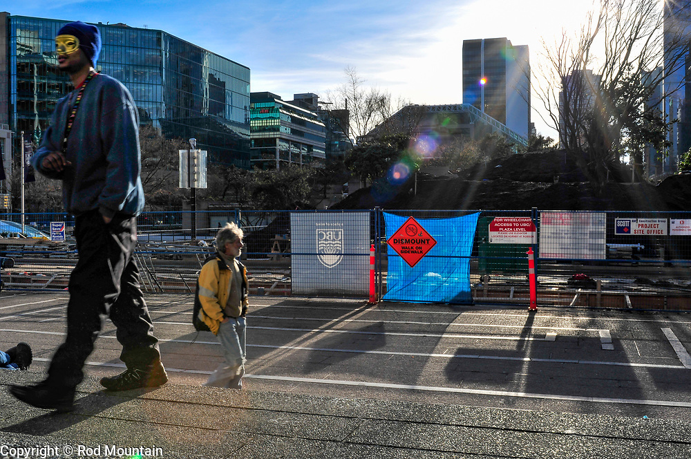 Vancouver, British Columbia - February 8, 2011 - A masked man walks along the steps of the Vancouver Art Gallery (Robson Street side).<br /> <br /> Image: © Rod Mountain<br /> <br /> www.rodmountain.com <br /> <br /> <br /> #friendsinperson #city #streetlife_award #friendsinperson #blackandwhite #RoamVancouver #socialdocumentary #bnw_guru #livefolk #agameoftones#igersone#bwmasters #blackandwhiteisworththefight #bnw_city #bwmasters #bnwsouls #bnw_zone #awesomebnw #blacknwhitepic #Downtown #latergram
