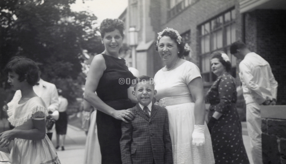 Grand mother and mother posing outside the school building