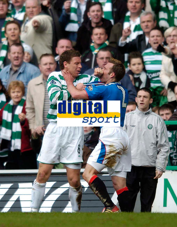 Photo. Jed Wee.,Digitalsport<br /> Glasgow Celtic v Glasgow Rangers, Scottish FA Cup, Celtic Park, Glasgow. 07/03/2004.<br /> Celtic's Alan Thompson (L), rumoured to be watched by England manager Sven Goran Eriksson, loses his cool and clashes with Rangers' Fernando Ricksen.