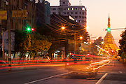 Light streaks from traffic and Sule Pagoda at end of the road, bus exposed