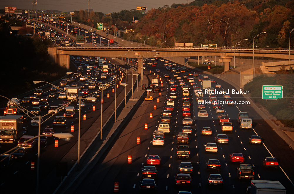 1990s evening rush-hour traffic at the junction of the 400 to Buckhead and the 401 highway, on 5th November 1995, in Atlanta, Georgia USA.