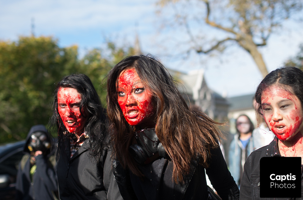 """Thousands of """"zombies"""" swarmed through the streets of Ottawa during the cities annual zombie walk. The zombies and a few survivors stumbled from City Hall to Parliament Hill in search of brains. Not only zombies were fed though. The Ottawa Food Bank also joined the zombies to collect donations. October 4, 2015.<br /> <br /> Captis Photos/Brendan Montgomery"""