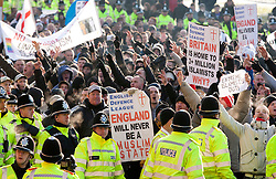 © under licence to London News Pictures 27/11/2010 today picture.The English Defence League held a National protest march through Nuneaton, Warwickshire earlier today. Police from forces as far away as Gloucestershire were called upon to contain the massed ranks of demonstraters.Pictured, EDL protesters make their way around Nuneaton ring road making gestures towards the Justice Centre..Picture credit: Dave Warren/London News Pictures...