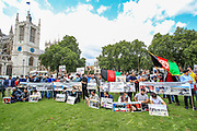 Afghan women along with their family members gathered outside the Houses of Parliament in central London on Wednesday, Aug 18, 2021 - to protest against the Taliban takeover of Afghanistan demanding that the international community no to recognise their government. British parliament is debating today the Crisis in Afghanistan. (VX Photo/ Vudi Xhymshiti)
