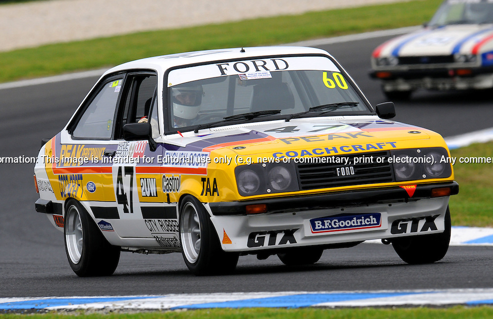Neville Butler - Ford Escort RS2000 - Group D.Historic Motorsport Racing - Phillip Island Classic.18th March 2011.Phillip Island Racetrack, Phillip Island, Victoria.(C) Joel Strickland Photographics.Use information: This image is intended for Editorial use only (e.g. news or commentary, print or electronic). Any commercial or promotional use requires additional clearance.
