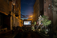 """Middletown, New York - People watch a free showing of Disney's """"McFarland USA"""" on the King Street Walkway on Aug.18, 2016."""