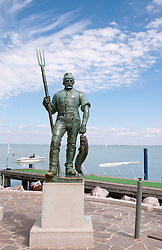 Statue of fisherman in Balatonfured harbour at Lake Balaton, Hungary