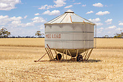 Mobile field bin grain silos in paddock after wheat harvest <br />