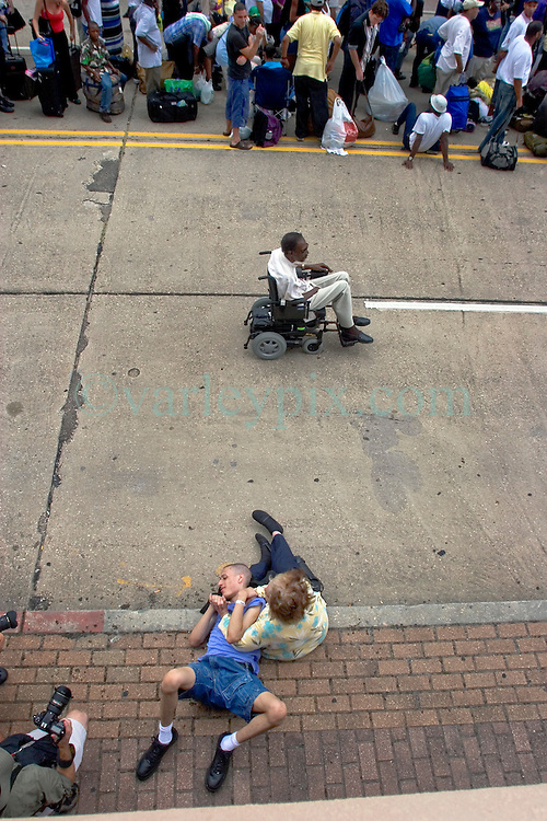 28th August, 2005. Hurricane Katrina, New Orleans, Louisiana. A special needs individual waits with thousands of people for a place of shelter in  the Superdome.