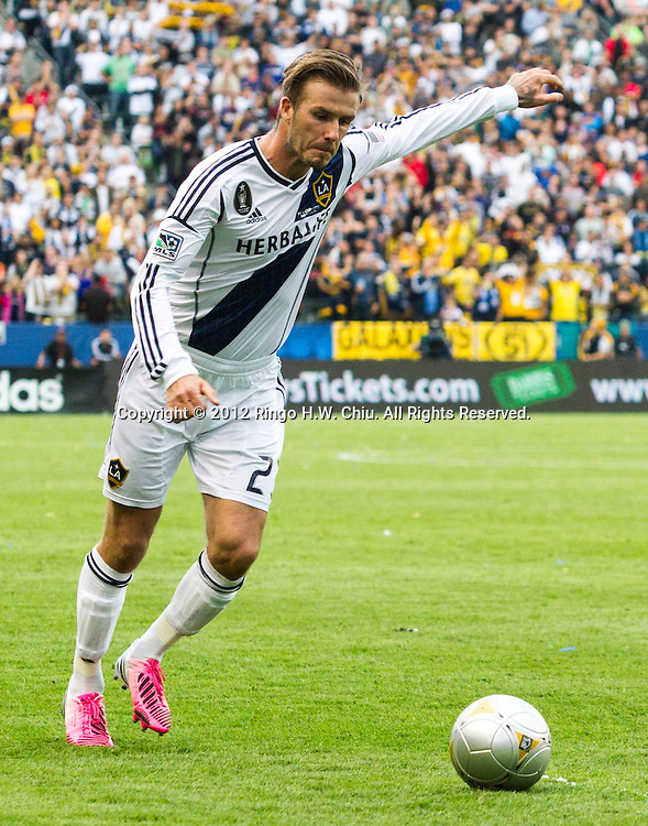 Los Angeles Galaxy star David Beckham #23 kicks a ball during his farewell game in the Major League Soccer (MLS) Cup final at the Home Depot Center on December 1, 2012 in Carson, California. The Galaxy defeated Houston Dynamo 3-1 to win the MLS Cup Championship. Beckham will be leaving the team after the game. He joined the L.A. Galaxy back on January 11, 2007, when he signed a 5-year contract worth $32.5million. He has played in over 98 games during his six season stint with the Galaxy and just last season was named an MLS all-star while notching a career best 15 assists in MLS play. (Photo by Ringo Chiu/ PHOTOFORMULA.com)..
