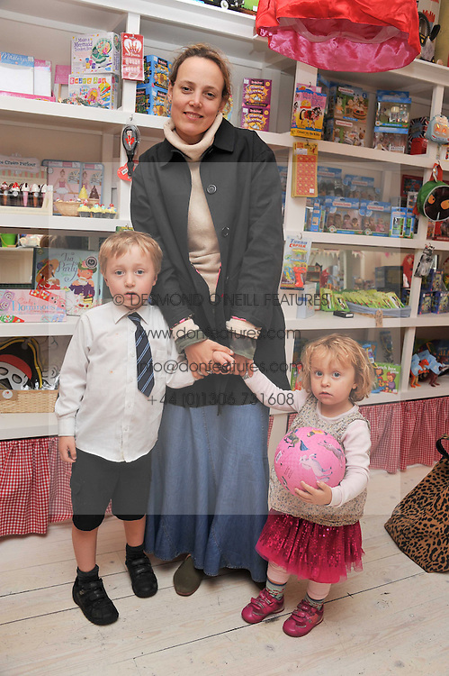 BAY GARNETT and her children SYLVIE & BILLY at the opening of the new HoneyJam children's store at 2 Blenheim Crescent, London W11 on 7th July 2011.