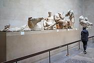 Tourist visiting The East Pediment of Parthenon. United Kingdom, London, British Museum
