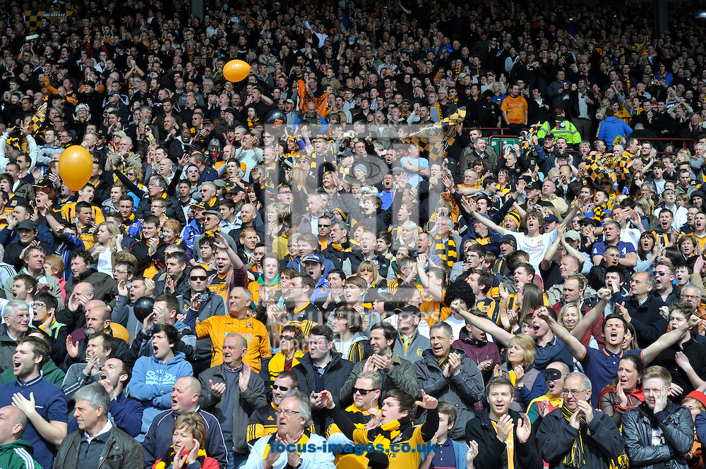 Picture by Richard Land/Focus Images Ltd +44 7713 507003.27/04/2013.Hull City fans welcome their team to the field during the npower Championship match at Oakwell, Barnsley.