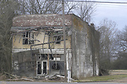 The old Bryant Store, the site where Emmett Till purportedly wolf-whistled at a white woman and was  later fond lynched, sat feb 29,2004. Till whilsed at Carolyn Bryant,the wife of Roy Bryant who along with J.W. Milam kidnapped and killed Till in 1955.(Photo/Suzi Altman) Old Bryant Store in Money Mississippi site of the Emmett Till murder.the old Bryant Store in Money, MS. from 11/27.02.The old Bryant store it has stood the test of time but is in bad shape and decaying. The store is where Emmett Till a young black man from chicago who stopped in the store and whistled or cat called at the owners blonde and white wife,Emmett was later found lynched and the men who were accused of the crime were found not guilty.The store owners was Roy Bryant it was his wife that was whistled at and Roy owned the store with his half brother J.W.Milam in 1955. Bryant and Milam were indicted for kidnapping and lynching Till but were later acquitted of all charges.(photo/Suzi Altman) Photo ©Suzi Altman
