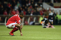 Football - Championship - Nottingham Forest vs. Blackpool<br /> Forest's Wes Morgan is left looking sorry for himself as the final whistle confirms Blackpool's place in the play off final at the City Ground