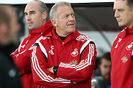 Swansea city caretaker manager Alan Curtis looks on from the dugout.  Barclays Premier league match, Swansea city v West Bromwich Albion at the Liberty Stadium in Swansea, South Wales  on Boxing Day Saturday 26th December 2015.<br /> pic by  Andrew Orchard, Andrew Orchard sports photography.