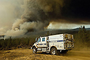Greeley Hill, California-- July 29, 2008-Telegraph Fire-Wildfires Threaten Yosemite National Park .Fire blows up near Halls Gulch and  Bull Creek Road. Kern County fire truck moves along the fire break. While things heat up in Division M of Branch Three.This Image was use by Associated Press Photo.AP Photo/Al Golub.
