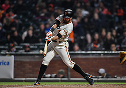 April 30, 2018 - San Francisco, CA, U.S. - SAN FRANCISCO, CA - APRIL 30: San Francisco Giants First base Brandon Belt (9) connects with the ball during the San Francisco Giants and San Diego Padres game on April 30, 2018 at AT&T Park in San Francisco, CA. (Photo by Stephen Hopson/Icon Sportswire) (Credit Image: © Stephen Hopson/Icon SMI via ZUMA Press)