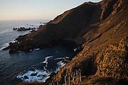 The sun sets on the steep coast and high bluffs above La Bufadora near Ensenada, Baja California Norte, Mexico.