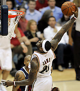 LeBron James rises for a slam dunk against Atlanta.
