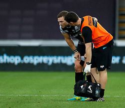 George North of Ospreys receives medical attention<br /> <br /> Photographer Simon King/Replay Images<br /> <br /> Guinness PRO14 Round 2 - Ospreys v Cheetahs - Saturday 8th September 2018 - Liberty Stadium - Swansea<br /> <br /> World Copyright © Replay Images . All rights reserved. info@replayimages.co.uk - http://replayimages.co.uk