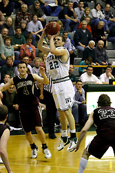 16 December 2006: Andrew Gilmore out flanks Brandon Woodhead for a jump shot at the 3point line. The University of Chicago Maroons upset  the Illinois Wesleyan Titans 64 - 60 at the Shirk Center in Bloomington Illinois.<br />