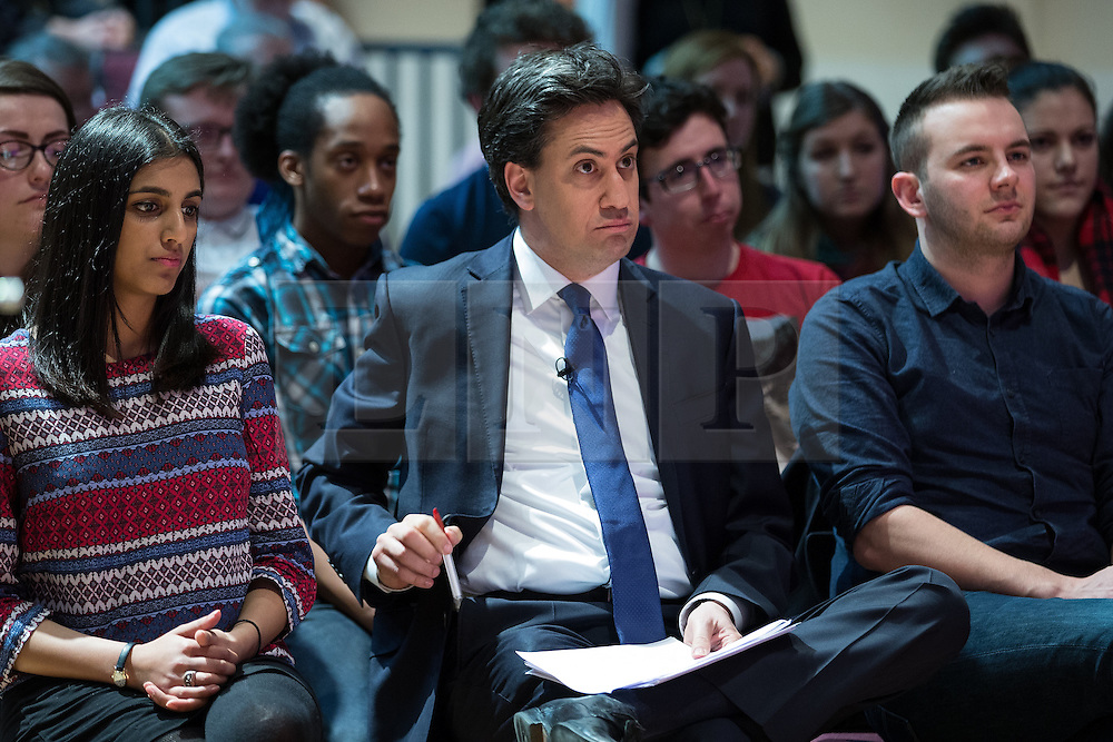 © Licensed to London News Pictures . 27/02/2015 . Leeds , UK . ED MILIBAND in the audience as Ed Balls speaks at the launch of the Labour Party's fourth election pledge at a speech on young people . British Labour Party leader Ed Miliband and Shadow Chancellor Ed Balls at Leeds College of Music today ( Friday 27th February 2015 ) . Photo credit : Joel Goodman/LNP
