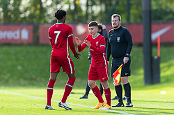 KIRKBY, ENGLAND - Saturday, October 31, 2020: Liverpool's substitute Mateusz Musialowski replaces James Balagizi (L) during the Under-18 Premier League match between Liverpool FC Under-18's and Newcastle United FC Under-18's at the Liverpool Academy. Liverpool won 4-1. (Pic by David Rawcliffe/Propaganda)