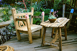 Rustic table and chairs on decking