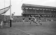 GAA All Ireland Minor Football final Cork V. Offaly 27th September 1964 at Croke Park..Cork goalie saves with S. Cawley (Cork) holding off Offaly forward M. Byrne. Also in picture C. mc Carthy (Cork) ..27.9.1964  27th September 1964