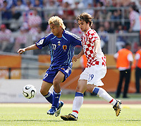 Photo: Chris Ratcliffe.<br /> Japan v Croatia. Group F, FIFA World Cup 2006. 18/06/2006.<br /> Niko Kranjcar of Croatia clashes with Junichi Inamoto of Japan.