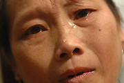 """Ms. Mee Moua Vang, pleads for help, near Vang Vieng, Laos, July 4, 2006.  Her message  to the world, """"My husband and two older daughters were killed by the communist while foraging for food.  My daughter Blee was attacked by the communist where her guts were sticking out and I was unable to help her so she died.  I miss her very much.  I am desperately suffering here with no help.  I ask you to come in and save us.  Bring us food.""""..**EXCLUSIVE, no tabloids without permission**"""