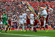 Ben Mee of Burnley heads towards goal but sees his effort saved by Liverpool Goalkeeper Simon Mignolet. Premier League match, Liverpool v Burnley at the Anfield stadium in Liverpool, Merseyside on Saturday 16th September 2017.<br /> pic by Chris Stading, Andrew Orchard sports photography.